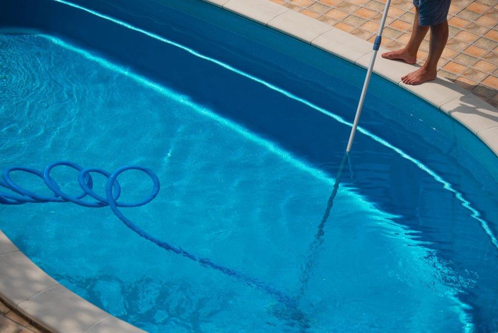 vacuuming the pool